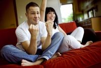 Man-and-woman-watching-football-together